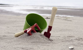 Shovel and bucket on the beach Stock Image