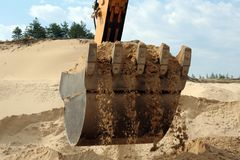 Shovel bucket full of sand Stock Photo