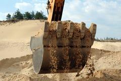 Shovel bucket full of sand. Working shovel bucket full of sand Stock Photo