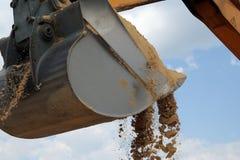 Shovel bucket full of sand. Working backhoe: shovel bucket full of sand Royalty Free Stock Photos