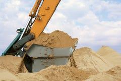 Shovel bucket full of sand. Working backhoe: shovel bucket full of sand Royalty Free Stock Image