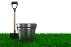 Shovel and bucket on grass. garden tool. Isolated 3D image Royalty Free Stock Photography