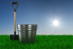 Shovel and bucket on grass. garden tool. 3D image Royalty Free Stock Photos