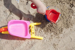 Shovel,  bucket and wheelbarrow beach toys Royalty Free Stock Photos