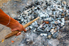 Shovel and burned cans and glass bottles. Royalty Free Stock Images
