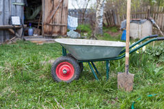 Shovel and the cart on a garden site Royalty Free Stock Photo