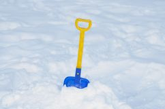 Shovel for cleaning of snow. Children`s shovel for snow removal.Toy for children in the winter Royalty Free Stock Photography