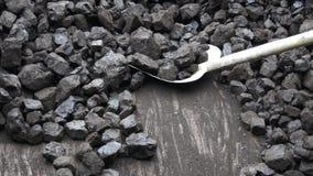 Shovel and coal. Lignite storage stock footage