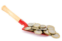 Shovel with  coins Stock Photography