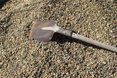 Shovel on crushed stone Royalty Free Stock Photography