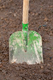 Shovel in the dirt in a garden Stock Photography