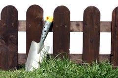 Shovel and fence Royalty Free Stock Photo