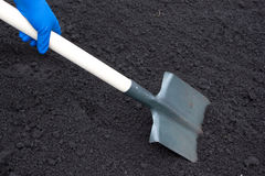 Shovel on field Royalty Free Stock Images