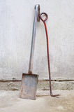 Shovel and fire iron. Near wall Stock Photography