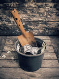 Shovel and flowerpot of American dollar on the wood background. Stock Photos
