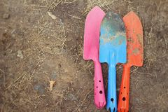 Shovel and fork for gardening on soil background Royalty Free Stock Photography