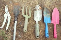 Shovel and fork for gardening on soil background Stock Images