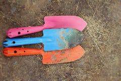 Shovel and fork for gardening on soil background Royalty Free Stock Image
