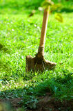 Shovel In Ground. Shovel plunged into the ground, left in a standing position Royalty Free Stock Photos