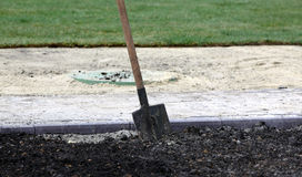 Shovel in the ground Royalty Free Stock Photos
