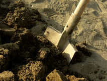 Shovel in the ground. Shovel in the ploughed ground Royalty Free Stock Photos