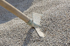 Shovel in a heap of grit. Old shovel in a heap of grit Royalty Free Stock Image