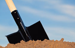 Shovel in the heap of ground Royalty Free Stock Photos