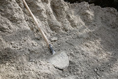 Shovel lying on a pile of construction material Stock Photography