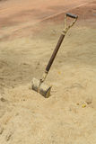 Shovel. The old shovel in the ground sand royalty free stock photography