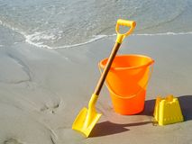 A Shovel and Pail on the Beach Stock Photo