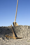 Shovel and pick. On a heap of gravel Stock Photography