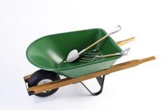 Shovel,Pick in green wheel barrel Stock Images