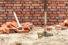 Shovel and pickaxe on a construction site Stock Photo
