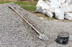 Shovel on a pile of gravel filled bucket Stock Images