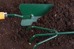 Shovel rake in land Stock Image