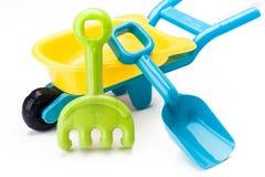 Shovel rake and wheelbarrow toy Royalty Free Stock Photo