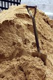 Shovel in sand. Shovel in a pile of sand at a construction site Royalty Free Stock Image
