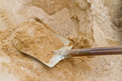 Shovel and sand Stock Photos
