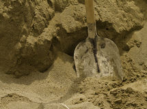 Shovel in the sand Stock Photo