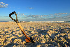Shovel in Sand at the Beach Royalty Free Stock Photos