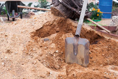 Shovel in sand Stock Images