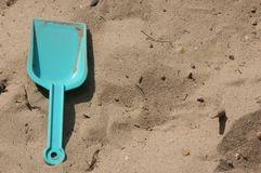 Shovel in the sandpit Stock Photos