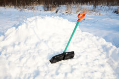 Shovel for snow cleaning sticks out in a snowdrift Stock Images