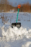 Shovel for snow cleaning sticks out Royalty Free Stock Images