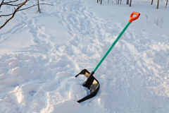Shovel for snow cleaning sticks Royalty Free Stock Photography