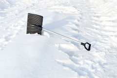 Shovel in snow, ready to removal snow stock photos