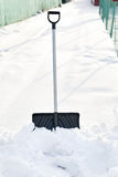 Shovel in snow, ready to removal snow Royalty Free Stock Photo
