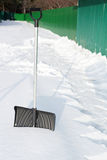 Shovel in snow, ready to removal snow Royalty Free Stock Photos