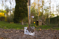 Shovel in soil. Standing in garden Royalty Free Stock Image