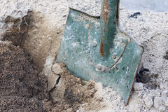 Shovel in soil closeup Stock Images